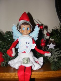 The Elf on the shelf~Elf Tooth Fairy gave a dollar bill folded into a little ring.