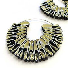 Min-ji cho - jewellery from rubber gloves. Just a great way to re-invent both your hoops earrings and...your rubber gloves,