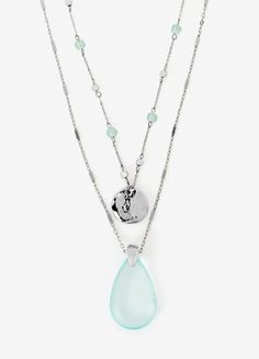 Adorned by a hammered silvertone disk and cloudy-blue teardrop pendant, each strand can be worn separately or together for maximum impact.