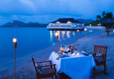 Candlelight dining on the beach is an unforgettable romantic experience at Sandals Halcyon Saint Lucia. #StLucia