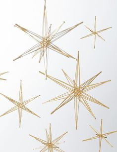 Foldable Star Sculptures - Design Within Reach Gold Stars, Stars And Moon, Sun Moon, Starry Night Wedding, Christmas Carol, Xmas, Celestial Wedding, Solar String Lights, Paper Stars