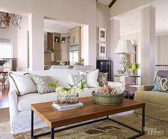 When it comes to painting great rooms, it's sometimes hard to know when to start and stop applying color. The simplest solution? Paint all adjoining walls and architectural details the same color so as not to disrupt visual flow. Further the link between kitchen, eating, and sitting areas with similarly hued accents. In this great room, sage green, silvery gray, brown, and white tones supply chromatic connections.