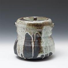 Mizusashi (water jar) by Lisa Hammond .  Black clay, poured shino, Height (cm):   16 . Width (cm):   17