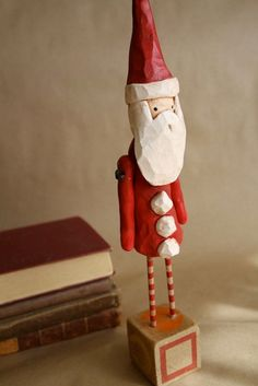 Folk Art Santa Claus Hand Carved from Trieste Prusso Design. $80.00, via Etsy.