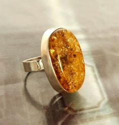 Large oval green amber ring  By IQJewelry on etsy.com