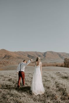 The rolling hills in this gorgeous landscape are almost as pretty as this beautiful bride's long, elegant bohemian wedding gown. This sheer, spaghetti strap wedding dress would make any eclectic bride look like a runway model. This adventurous couple chose to take their engagement photos in nature and therefore hired an elopement photographer based in the smoky mountains. Do you need an adventure wedding photographer in the smokies? Look no further, check out www.emilyrcrisp.com Elope Wedding, Boho Wedding, Wedding Hair, Destination Wedding, Wedding Dresses, Elopement Ideas, Elopement Inspiration, Elegant Bride, Beautiful Bride
