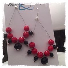 Handmade Red and Black Teardrop Earrings Round red Czech beads and black faceted crystals, strung in a teardrop shape. Jewelry Earrings