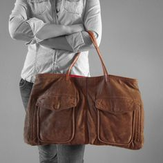 upcycled leather handbag from a weathered brown bomber jacket! love! $149.00