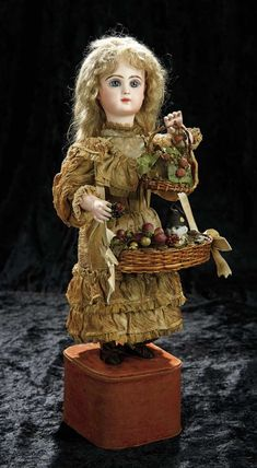 """Soirée: A Marquis Cataloged Auction of Antique Dolls and Automata - May 14, 2016: Lot 156. French Bisque Automaton """"Young Girl with Surprise Basket"""" by Leopold Lambert"""