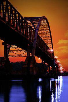 Kahayan bridge, Palangkaraya, Kalimantan, Indonesia.  Sunset at Kahayan                              ..