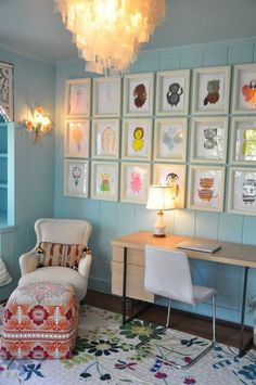Children's art, elevated: I love how the white frames against the blue wall unify  the fearless array of colors.