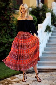 boho look with a bright print maxi skirt and off the shoulder top