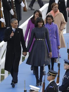 President Barack Obama, first lady Michelle Obama and Malia and Sasha Obama and Michelle Obama's mother Marian Robinson walk down to the Presidential reviewing stand in front of the White House, Monday, Jan. 21, 2013, in Washington.