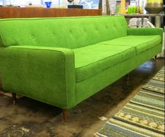 Vintage sofa with new green woven fabric.