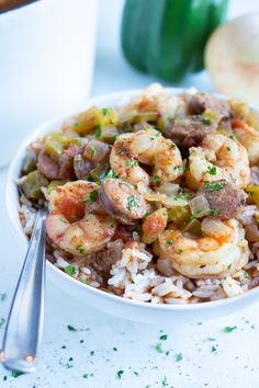 The smell of New Orleans' cuisine will fill your house as you snuggle up to a bowl full of this Shrimp and Sausage Gumbo. With its' rich, chocolatey brown color (all thanks to a homemade roux!), spicy Cajun flavors, and bites of andouille sausage and shrimp in every bite. This classic Louisiana recipe is perfect for a Mardi Gras celebration or enjoying all year-round! #gumbo #shrimp #sausage Louisiana Recipes, Cajun Recipes, Seafood Recipes, Gluten Free Gumbo Recipe, Shrimp And Sausage Gumbo, Cajun Shrimp, Lunch Recipes, Healthy Recipes, Healthiest Seafood