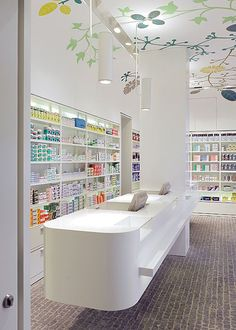 Front counter where the register would be but not a fan of the ceiling design I would want something different Hospital Pharmacy, Pharmacy Store, Pharmacy Humor, Design Exterior, Shop Interior Design, Medical Office Design, Counter Design, Hospital Design, Cosmetic Shop