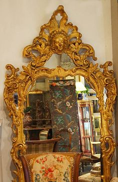 Very fine, French, Regence style mirror: In solid, carved giltwood with original mercury glass.  Second half of the 19th century.Provenance: Formerly part of the furnishings of the Chateau St. Laurent en Isore.  Grenoble, France.La Famille Terray.