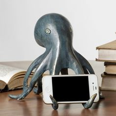 http://fancy.com/things/592581971087983607/Octopus-Cell-Phone-Holder-&-Bluetooth-Speaker?utm=shop