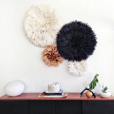 20 Ways to Decorate with African Juju Hats - Feather Headdresses - Interior Design - Entryway Decorated with Juju Hats Cluster