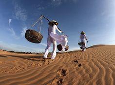 Two Vietnamese ladies walk home along the popular sand dunes in Mui Ne in Phan Thiet, Vietnam