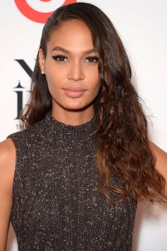 32 Celebrity Curly Hairstyles We Love: Joan Smalls Joan Smalls flaunts her born-with-it curly textured tresses.