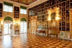 """Cabinet of Fashions and Graces (or the Painting Hall) in the Petehof Grand Palace, Russia. """"After Pietro Rotari's death in 1762, Catherine the Great (whom he had painted three times) bought from Rotari's widow all of these paintings and used them to decorate one of the rooms of the Petehof Grand Palace. Decorated by Jean-Baptiste Vallin de la Mothe, the Cabinet of Fashions and Graces (or the Painting Hall) contains 328 of Rotari's portraits, covering every wall almost from floor to ceiling."""""""