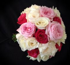 A mix of garden roses and open normal roses  in different pinks and white.
