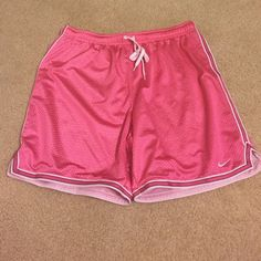Nike women's basketball shorts Pink basketball shorts drawstring on outside of waistband. Nike Shorts Skorts