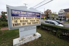 OYSTER BAY, NY - OCTOBER 28: The North Shore Community Church displays a sign alluding to Hurricane Sandy on October 28, 2012 in Oyster Bay, New York.