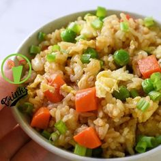 Chinese fried rice made with fragrant jasmine rice carrots peas and scrambled eggs This easy stir-fried dish turns plain white rice into flavorful grains lightly seasoned with soy sauce and tossed with colorful vegetables friedrice chinesefood video Asian Recipes, New Recipes, Vegetarian Recipes, Dinner Recipes, Cooking Recipes, Vegetarian Dish, Cheap Recipes, Recipes With Rice Easy, Snack Recipes