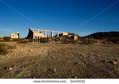 Abandoned factory - rural spanish scenery, dry soil by MilaCroft, via ShutterStock