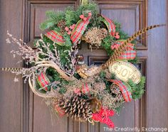 Christmas wreath mixed with Spanish moss, pine cones, antlers and pheasant. Love the natural elements. Hope I can find a pheasant like this at the craft store. I do have tail feathers.