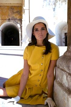 Ali MacGraw in a yellow suit by Jacques Tiffeau, white felt floppy hat by Emme, and white kid gloves. Photo by Sante Forlano, 1967.