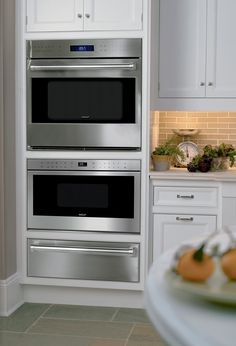 """""""MADE FOR EACH OTHER To create a beautifully coordinated suite of Wolf appliances, the built-in ovens are designed to be installed in a """"tower"""" configuration with other Wolf cooking products, including the convection steam oven, drawer-style or door-front microwave, and warming drawer."""" Love this combo"""