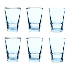 Pale blue glasses to make into vases. Tie ribbon around the bottom and add stones, water and flowers.
