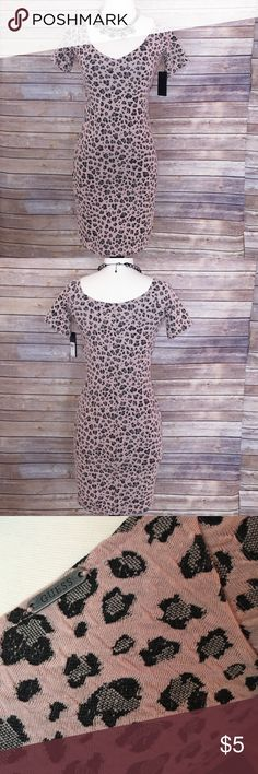 """Guess leopard dress Body-sculpting minidress. The jacquard design lends exotic texture. Size small: bust 36""""; waist 26-27""""; hips 36"""". Still has tags - never worn!  short sleeve dress by guess off-the-shoulder neckline v neck all over leopard print form fitting approx. length of side seam 73 cm 97% polyester 3% spandex Guess Dresses Mini"""