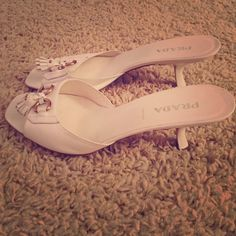 """Prada white kitten heels. Vintage. Authentic Prada kitten heels. 100% leather. 2.5"""" heel. Rose gold detail with white leather tassel. Worn approximately 5 times. Purchased in London. Made in Italy. Prada Shoes Heels"""