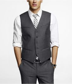 Medium-Dark gray suit pants and vest but with light blue shirt and navy tie.