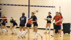 To increase defensive awareness and improve their passing ability, the Premier Volleyball team performs the Caterpillar Drill during an on-court practice session.