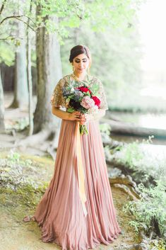 6fb573daaef61 Peach ribbon trails down from wedding bouquet to create a highlight against  the earthy mauve undertone of the bride s evening gown