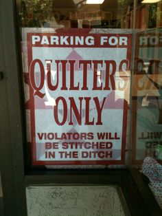 Quilters Only parking sign.