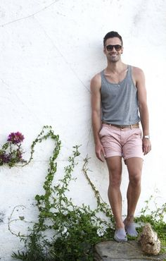 Shop this look on Lookastic:  http://lookastic.com/men/looks/sunglasses-tank-belt-watch-shorts-driving-shoes/10629  — Dark Brown Sunglasses  — Grey Tank  — Brown Leather Belt  — Silver Watch  — Pink Shorts  — Grey Suede Driving Shoes