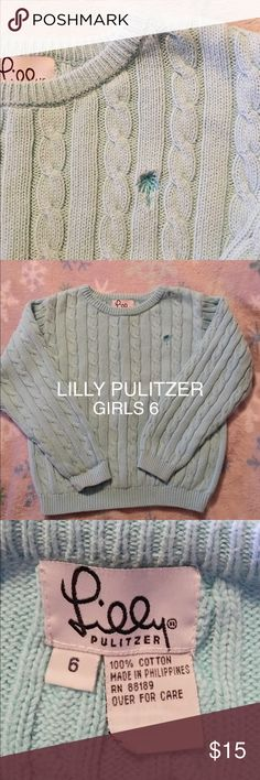 Girls Ribbed Sweater By Lilly Pulitzer This sweater is so cute and in GUC. The only flaw is  slit on the seam on bottom of the sleeve as pictured. If you like to sew it can be easily fixed. I just don't have the time. My price will reflect this flaw. Otherwise it's in good  condition. No balling or tears or stains. Lilly Pulitzer Shirts & Tops Sweaters