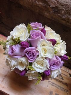 Lavender and white with roses and tulips! #weddingflowers #bridebouquet