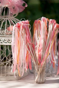 Ribbon wands - - Guests wave them as A leave reception outside. Double as decorations by the birdcage or something.