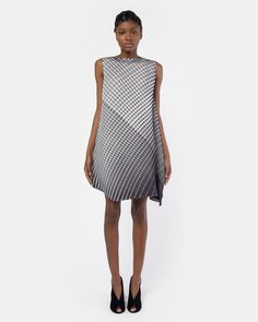 Shift Dress in Grey/Black Pattern by Issey Miyake Pleats Please. An asymmetrical sleeveless shift dress with a 60's inspired mod like feel; features include asymmetrical arm holes and an asymmetrical