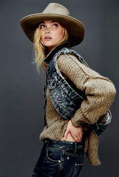 denim vest, slouchy sweater, felt wide-brimmed hat.