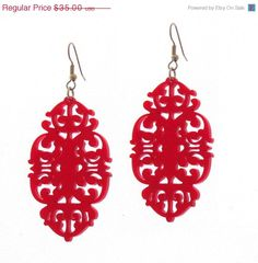 These unique Victorian design statement earrings are made from red acrylic, they hang on black plated over brass earwires and measure 2.6 inches tall by 1.4 inches wide (66X36 mm).    These earrings make a bold statement, yet are surprisingly lightweight and easy to wear.    All of my jewelry comes with a gift box.   $35