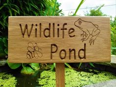 Wildlife Pond Oak Sign  Oak Plaque on back stake  Lettering and images carved into the sign  Dimensions of plaque: 20cm x 9cm x 2cm  Length of back stake from base of plaque to point: 23cm  Finished with coats of plant oil  Makes a lovely gift