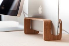The MacBook Rack is a vertical MacBook stand. It class up your work space.